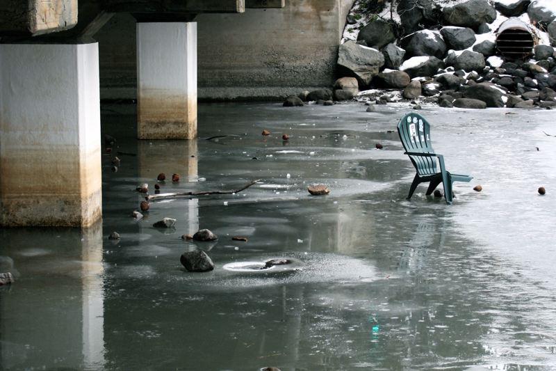 A broken chair left on the ice, Truckee River, Tahoe City.