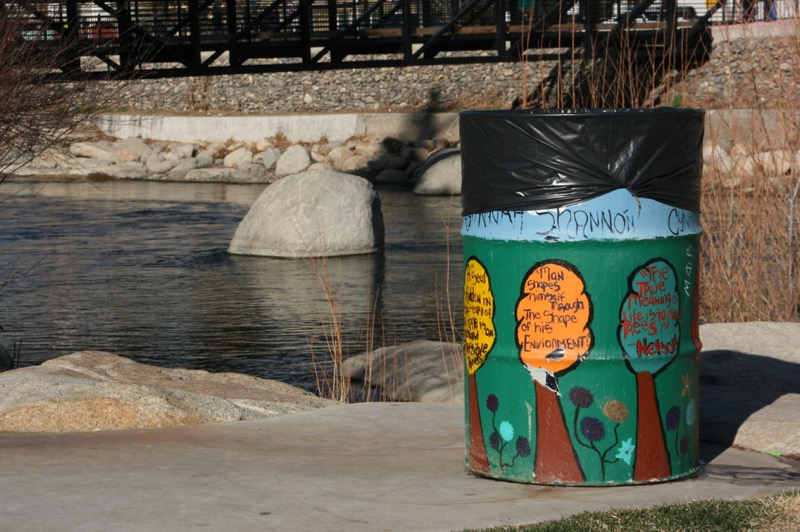 See these attractively painted trash cans? Use em.
