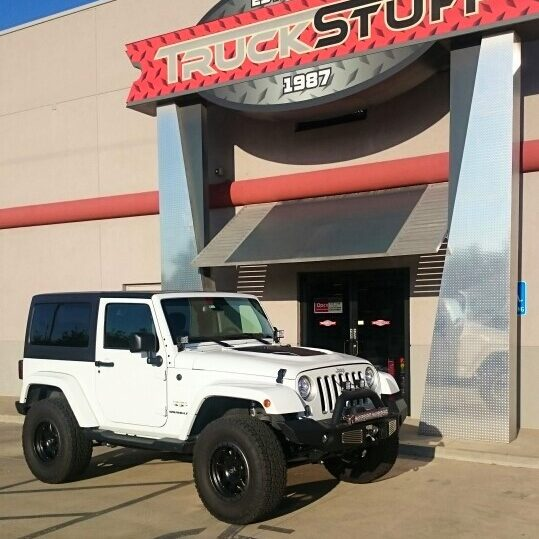 White Jeep parked at Truck Stuff entrance