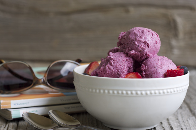 Greek yogurt with mixed berries to make a healthy alternative to ice cream.