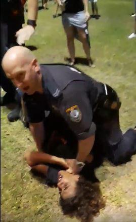 Husky Carnival Police Manhandling of Indigenous Boy 2