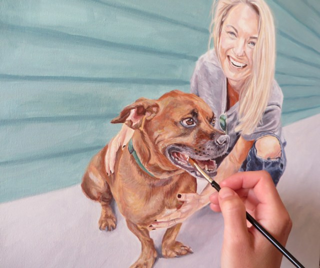 finishing touches to a dog and owner portrait