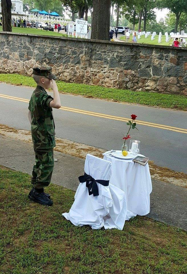 This little guy wanted to set up a Fallen Soldiers table in the cemetery, and he wasn't al ...