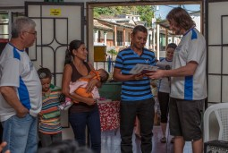 Milton & Florinda and their family receiving the keys to their new home from Trevor