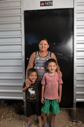 Mirna and her boys Gerardo & Irvin in front of their new house