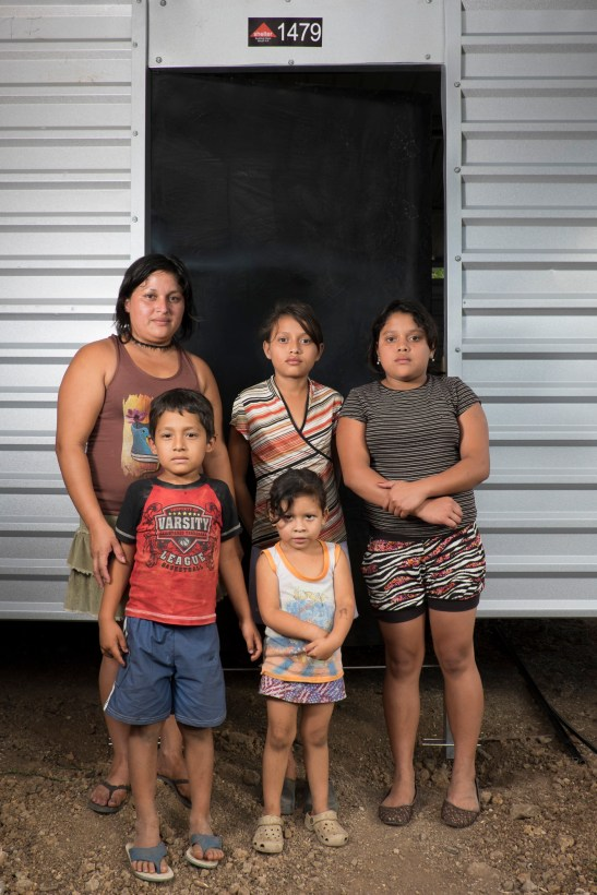 Idalia and her four children: Gerardi, Sofia, Diana & Kenedy in front of their new home.