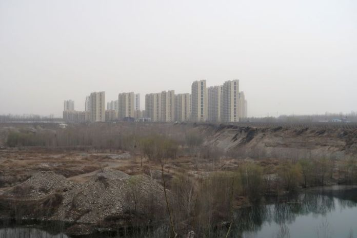 China's new home prices grow at slowest pace in eight months on cooling measures