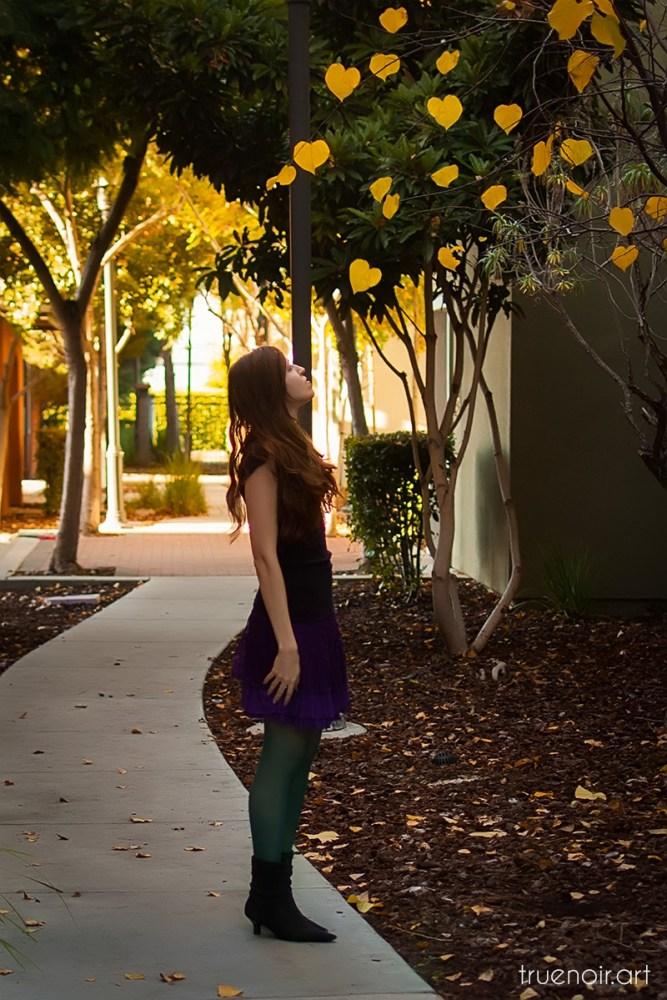 Oksana staring at yellow leaves on the tree
