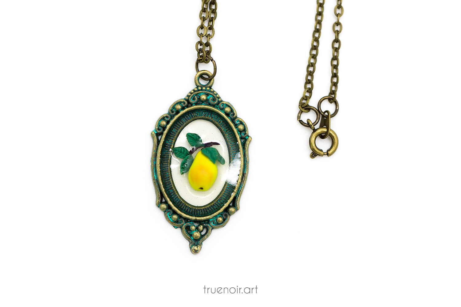Floating pear pendant and necklace closure.