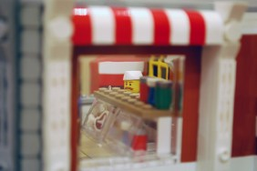 The display cases and chef as seen through the window of my LEGO Corner Deli.