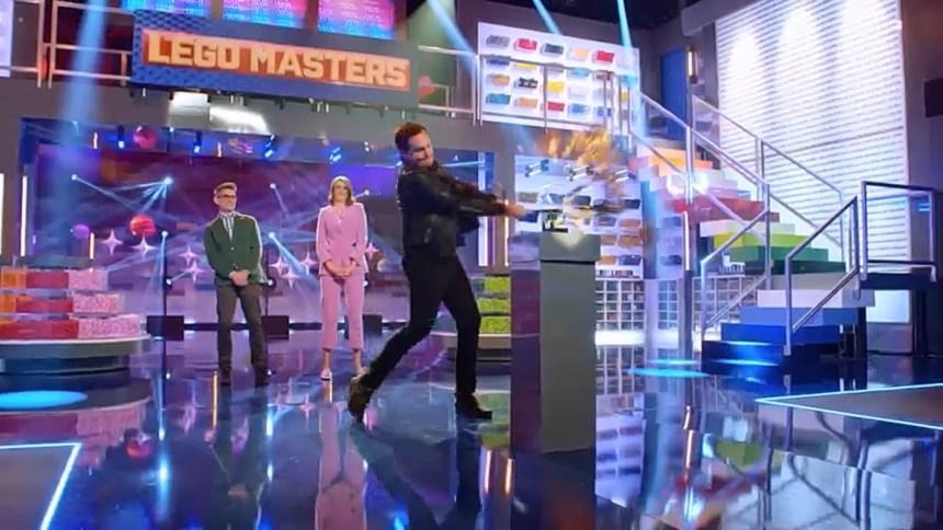 Will Arnett smashing LEGO with a bat.