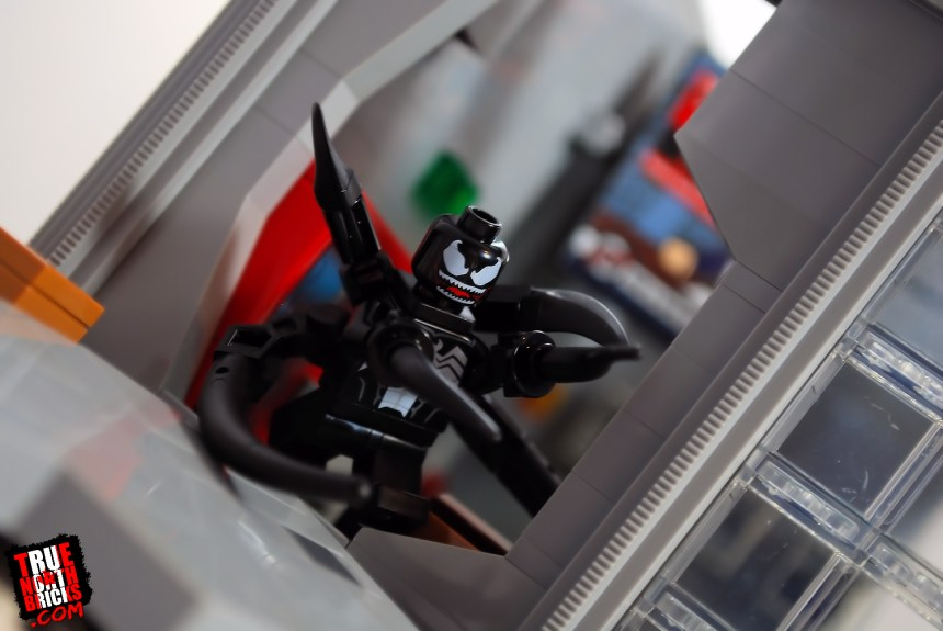 Venom busting through wall in the Daily Bugle (76178) set.