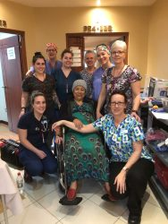 The Ward team poses for a picture with one of our patients.