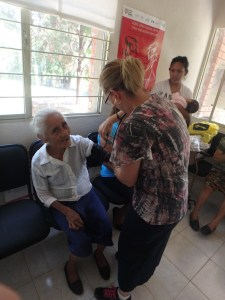 Tonyia took the vital signs of this older lady who came to the clinic.