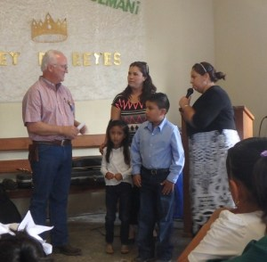 Pastor Reynaldo's daughter Ariel and son Abdiel presented Steve with a Father's Day certificate.