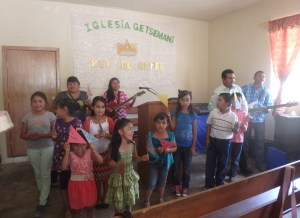 "The kids at Getsamani Church made little flags that said ""Feliz Cumpleanos"" (Happy Birthday). They also sang Happy Birthday in English! I found out later they had practiced all week."