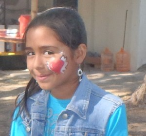 This girl is proud of her face paint.