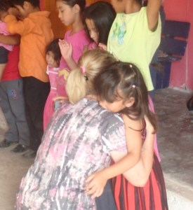 Tonyia hugged all the children while everyone prayed for them. Life can be difficult for them in this remote mountain village.