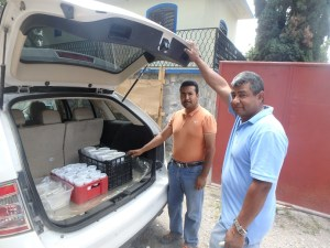 Pastor Reynaldo and Martin load the meals. We always pray over them before we hand them out.