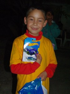 This boy was happy with a Hot Wheels car that was one of the items in his gift bag.