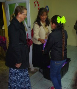 Tonyia and Belinda handed gifts to the girls.