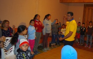 Each week Pastor Jose from Dieciocho de Marzo leads a time of song, usually with body motions.