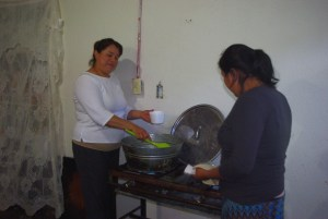 Sandra (left) and Lulu always cook a good meal for the elderly on Tuesday.