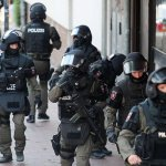 German armed police smash their way into mosque and raid homes