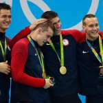 Michael Phelps Powers U.S. to Victory Winning a 19th Gold