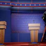 Commission: Both Candidates Must Stand for First Debate