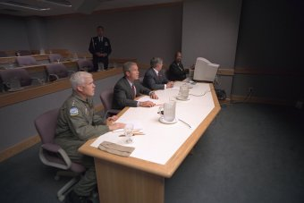 president-bush-admiral-richard-mies-left-and-white-house-chief-of-staff-andy-card-conduct-a-video-teleconference-at-offutt-air-force-base