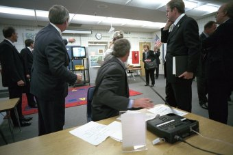 president-bush-watches-television-coverage-of-the-attacks-on-the-world-trade-center-during-a-briefing-in-the-classroom