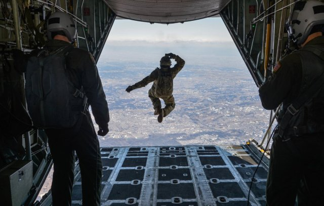tech-sgt-benjamin-jonas-the-374th-operations-support-squadrons-survival-evasion-resistance-and-escape-operations-nco-in-charge-jumps-out-of-a-c-130-hercules-while-flying-over-yokota-air-base