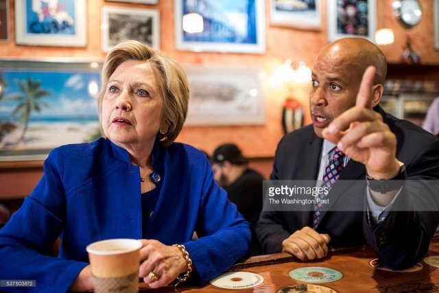 NEWARK, NJ - Democratic Candidate for President former Secretary of State Hillary Clinton, and Senator Cory Booker (D-NJ), orders and enjoys Cuban coffee at Omar's in Newark, New Jersey on Wednesday, June 1, 2016. (Photo by Melina Mara/The Washington Post)