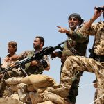 Iraq peshmerga storm Islamic State town as army battles in Mosul