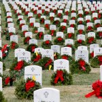 Christmas Spirit: Thousands help lay wreaths at Arlington National Cemetery