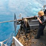 U.S. says Navy ship fired warning shots at Iranian vessels