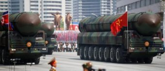 Intercontinental ballistic missiles (ICBM) are driven past the stand with North Korean leader Kim Jong Un and other high ranking officials during a military parade marking the 105th birth anniversary of country's founding father Kim Il Sung, in Pyongyang April 15, 2017. REUTERS/Damir Sagolj