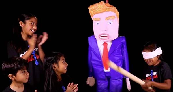 Adorable: Children (and grown-up kids) celebrate May Day by hanging, decapitating Trump piñatas