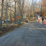 Upper parking lot to be paved and curbed