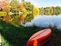 Red canoe and October foliage (photo by Wendy Blank)