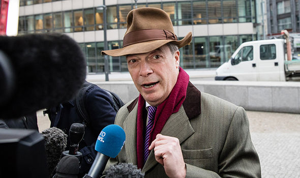 Nigel Farage speaks to journalists in Brussels