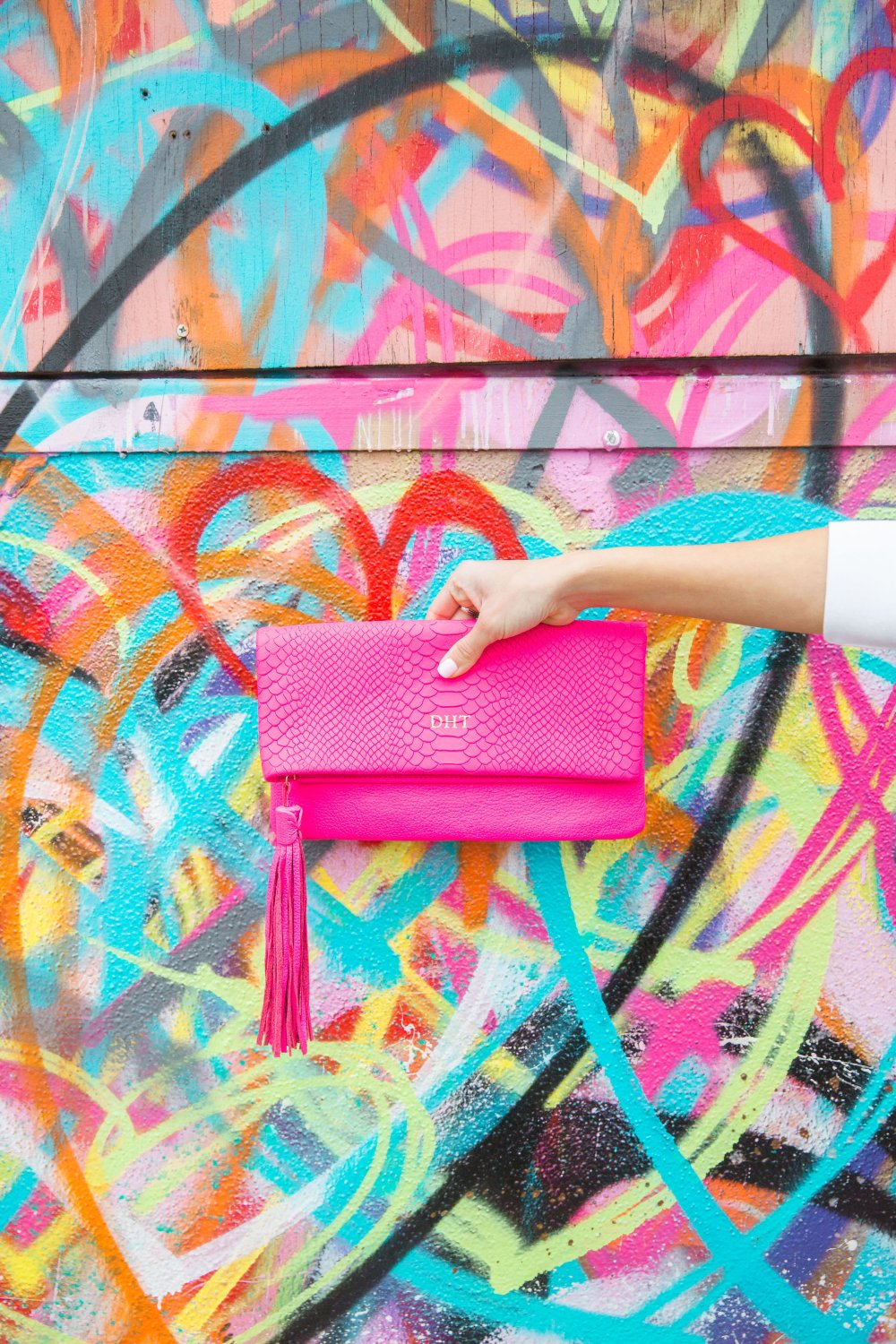 I am head over heels for this HOT PINK clutch! It adds a pop of fun to any outfit!