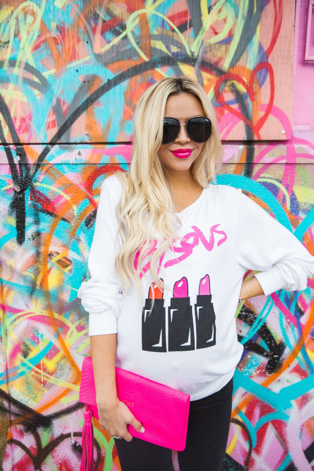 Sweatshirts just belong in maternity wardrobes! This one from Bison is super comfy, can be dressed up with heels, or down with sneakers! Loving the lipstick graphics!