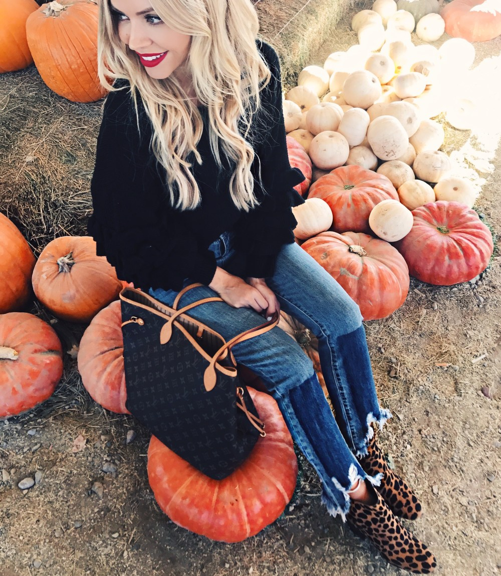 In love with these distressed, shark bite denim jeans! And the Leopard print booties! Perfect fall outfit.