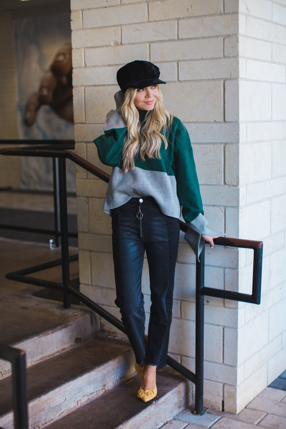 These high-waisted jeans and unique zipper detail complete this trendy fall outfit! The sweater is super soft and the velvet hat give off a cool vibe!