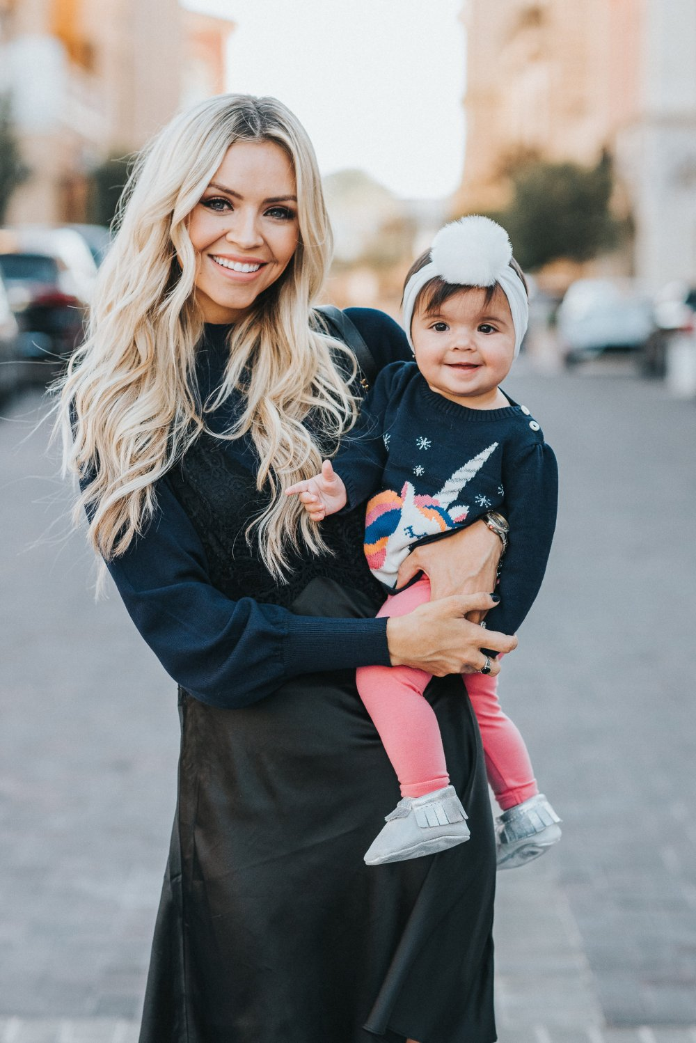 Mother-Daughter photoshoot! I am loving sweet girls' unicorn sweater and pom headband! My slip dress with sweater is perfect for fall or winter! It is comfortable and very versatile! These tall black boots are to die for! #motherdaughter #fashion #girlsfashion #unicorn