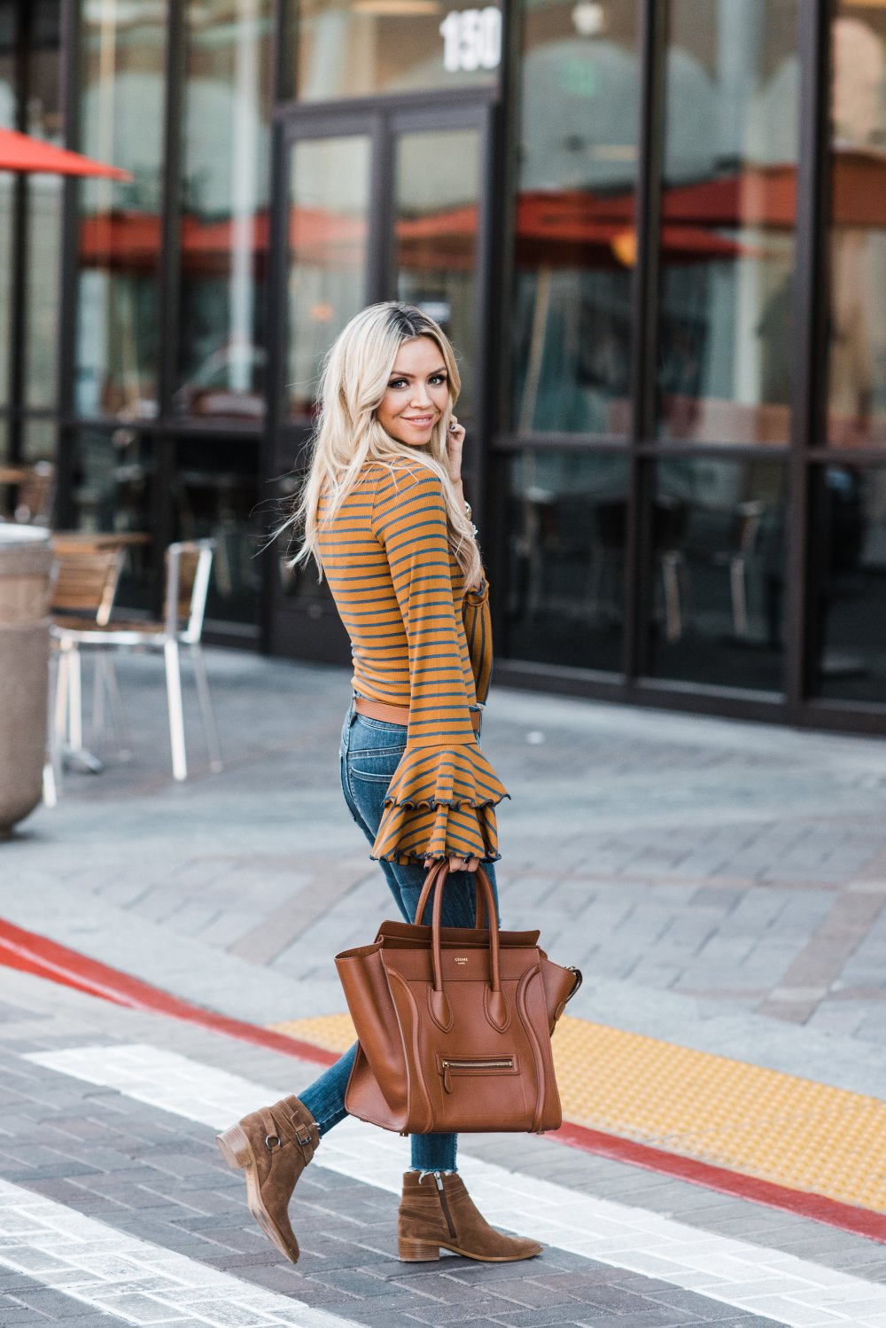 Flare sleeves are all the rage! This striped flare sleeve top is great for the cool weather! It comes in a few different colors!