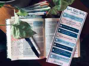 quick bible study checklist laid on open bible