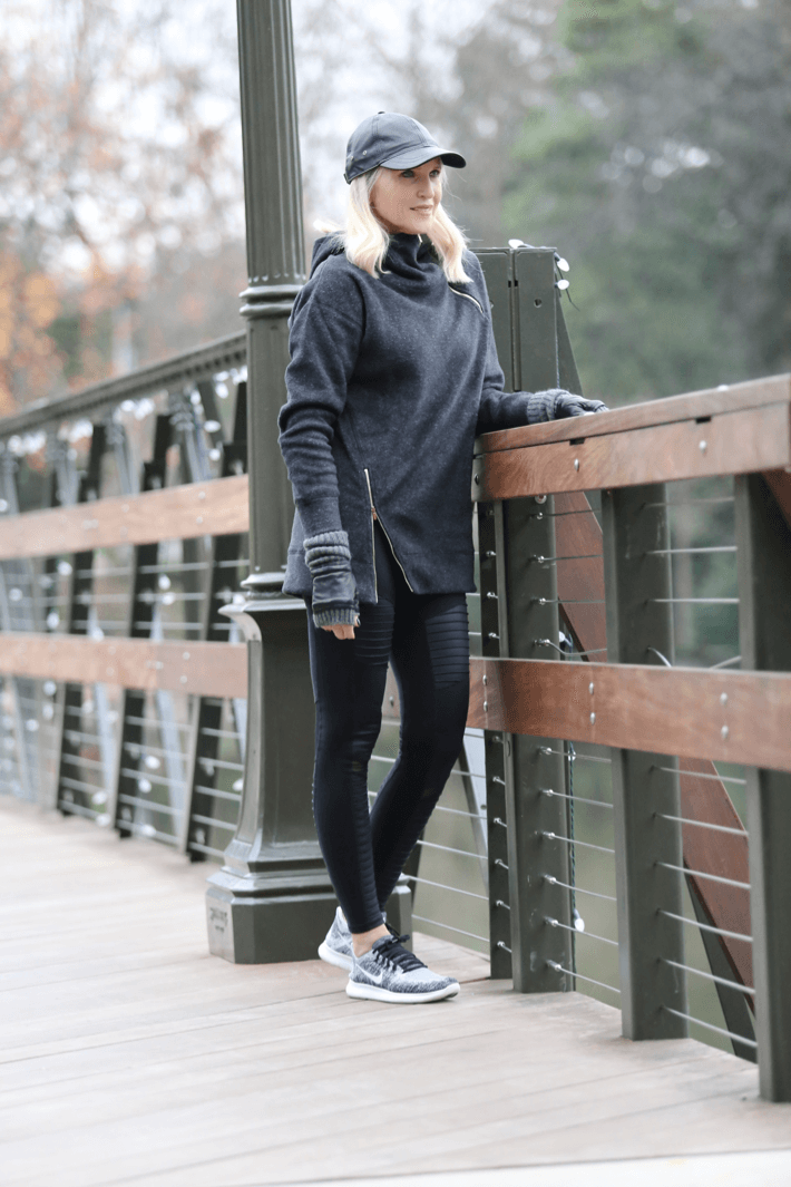 Dallas lifestyle blogger 'Truly Megan' in Alo Yoga moto leggings and nike fly knit.